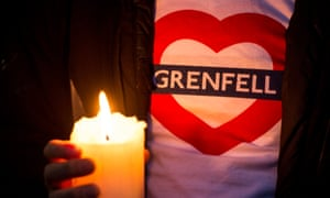 A candle is held during a silent march last year for those who died in the Grenfell Tower fire