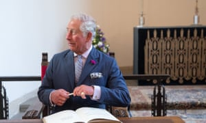 Prince Charles signs a visitors book at Llandaff Cathedral in Cardiff