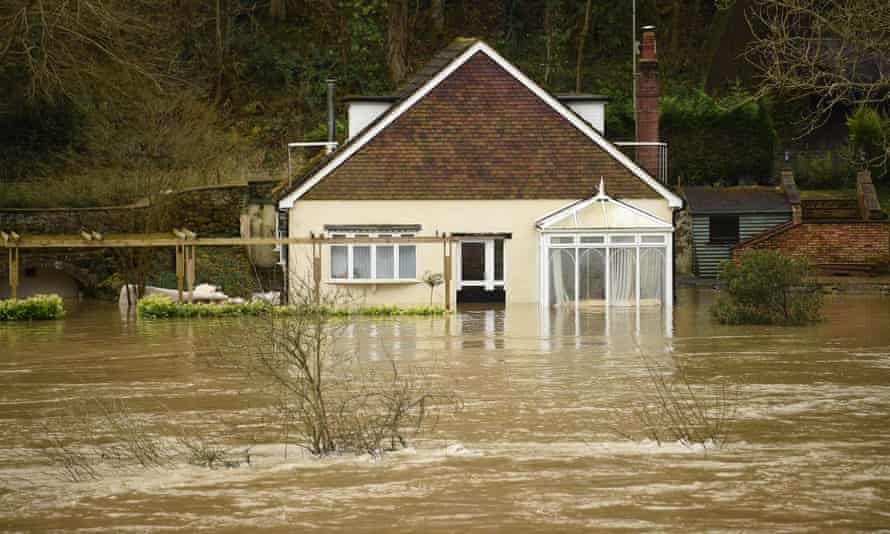 A house in flood water in Ironbridge, Shropshire, last year. In 2019, the CCC warned that the UK had no proper plans for protecting people from flash flooding.