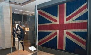 Horatio Nelson's uniform, left, and the union flag that flew at the Battle of Trafalgar at the National Maritime Museum.