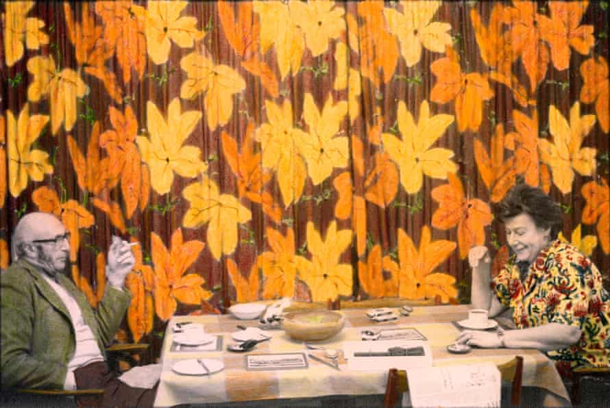 The Goldblooms sit at a table
