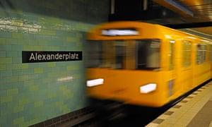 U-bahn train enters Alexanderplatz station
