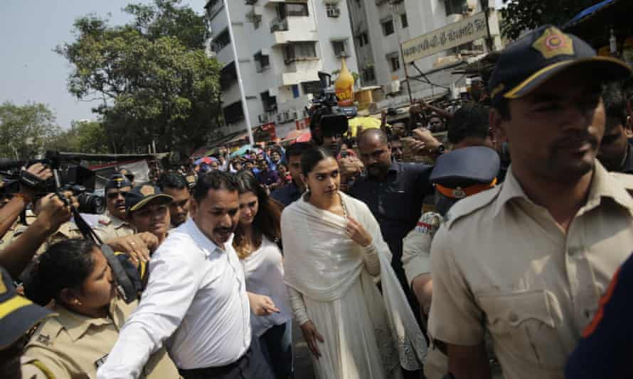 """Bollywood actor Deepika Padukone, centre, arrives escorted by police to offer prayers at a Hindu temple ahead of the release of her upcoming film """"Padmaavat"""" in Mumbai on Tuesday"""