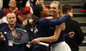 Katie Boulter of Great Britain is congratulated by captain Anne Keothavong after winning her round robin match against Kaja Juvan of Slovenia.