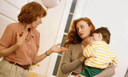 Mother with son in discussion with older female relation