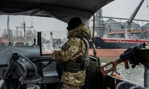 A Ukrainian sea border security force soldier guards Mariupol port on the Azov Sea.