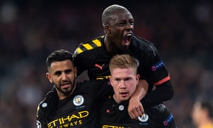 Riyad Mahrez and Benjamin Mendy congratulate Kevin De Bruyne after the Belgian's penalty gave Manchester City a 2-1 win at Real Madrid in the Champions League last-16 first leg