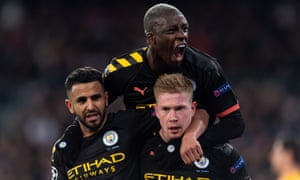 Kevin De Bruyne is embraced by Riyad Mahrez and Benjamin Mendy after scoring during Manchester City's first-leg win at Real Madrid