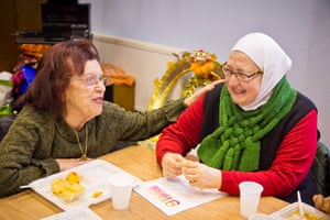 Yanet (l), originally from Egypt, and Susan (r), a refugee from Syria, meet at Bristol's International Peace Cafe.
