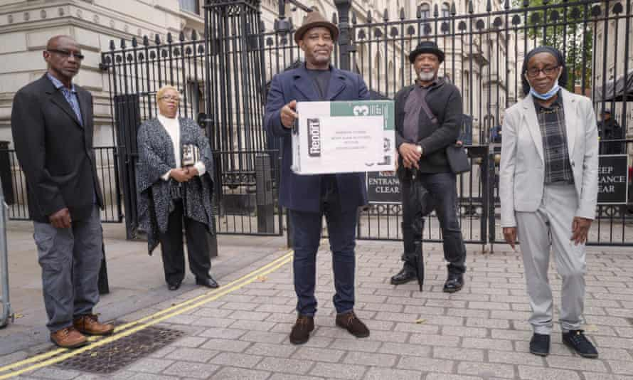 From left to right: Michael Braithewaite, Glenda Caesar, Anthony Bryan, Elwardo Romeo and Paulette Wilson presented a petition to Downing Street on 19 June, demanding full compensation for the victims.