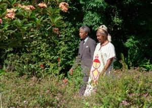 Nelson and Winnie Mandela stroll in the garden of Archbishop Desmond Tutu's residence