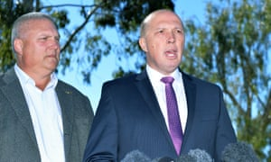 Peter Dutton (right) and Liberal National party candidate for Longman, Trevor Ruthenberg, in Brisbane on Friday.