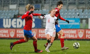Beth Mead of England tussles with Andrea Jarchovska (right) and Petra Bertholdova before tumbling to the turf.