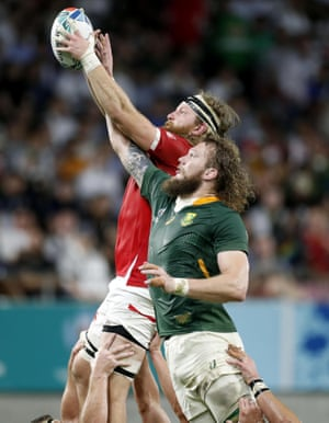 Canada's Evan Olmstead and South Africa's RG Snyman compete for lineout ball.