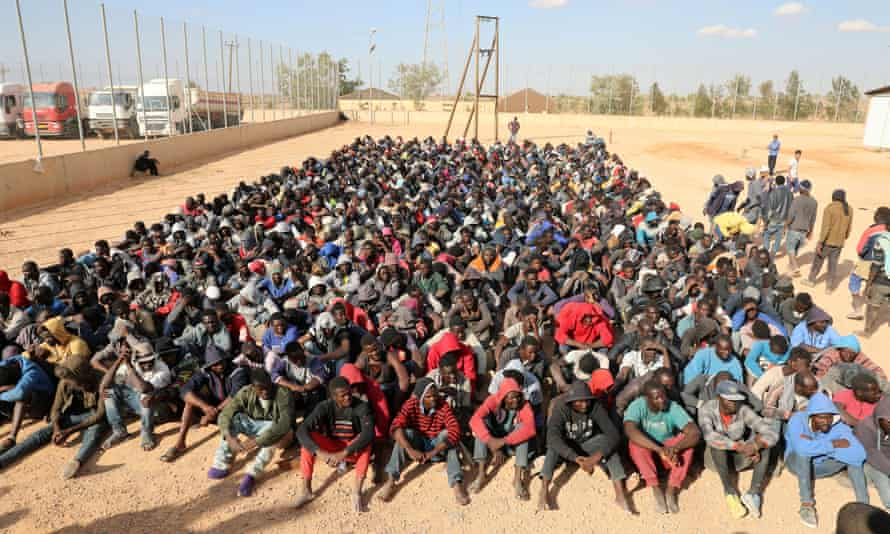 Hundreds of migrants being held at a detention centre in Gharyan, Libya.