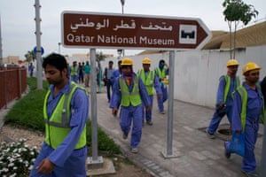 Labourers on their way to work at Qatar's national museum.