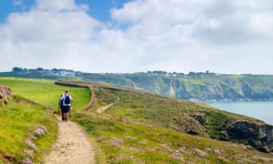 Walkers on the South West Coast Path on the Lizard Peninsula.