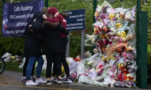 Flowers left outside Cults academy, where 16-year-old Bailey Gwynne died after being stabbed.