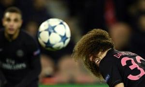 Paris Saint-Germain's David Luiz heads the ball