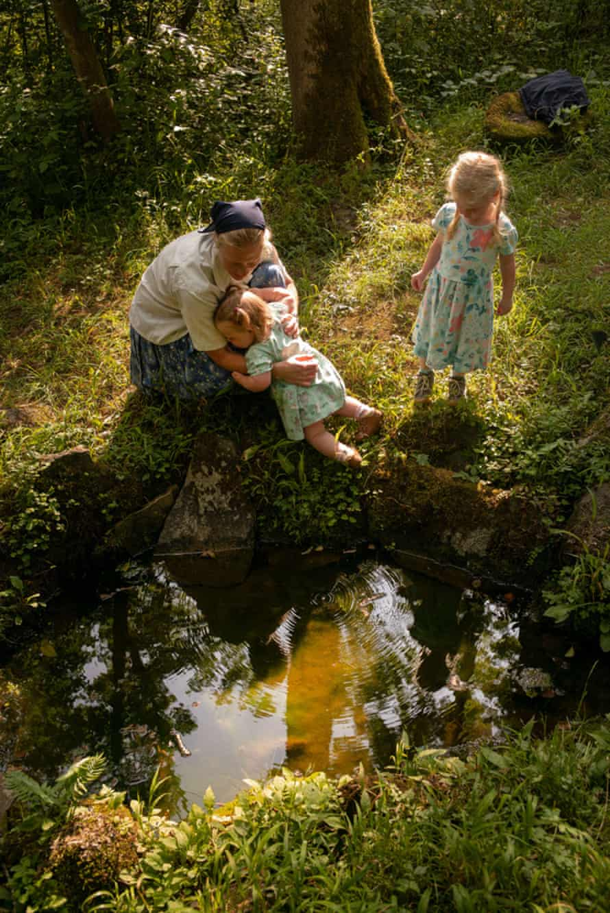Mim with her daughters at the baptism spring, Sannerz, Germany.