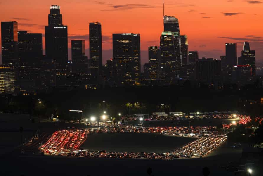 Motorists wait in lines to take a coronavirus test in a parking lot at Dodger Stadium in Los Angeles.