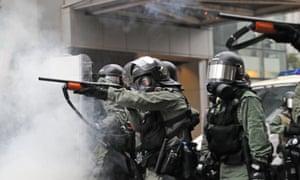 Riot policemen confront demonstrators in Hong Kong.