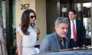 George and Amal Clooney were pictured with David Miliband outside the Palm restaurant in LA.
