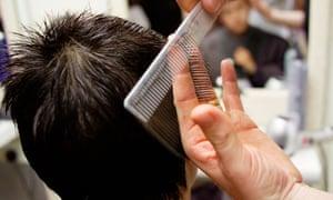 Teenage boy having his hair cut