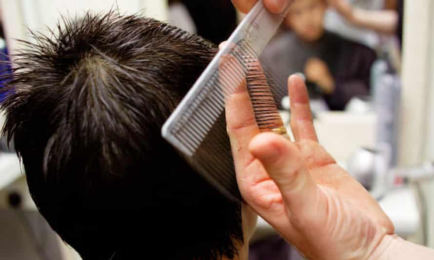 Teenager having his hair cut at a barbers
