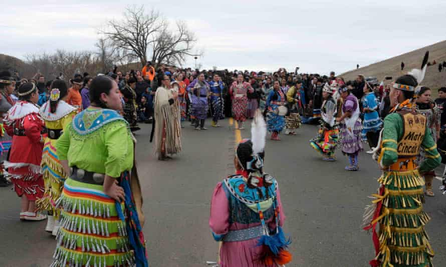 Native American dancers perform during a peaceful demonstration near the Dakota Access pipeline site on 29 October.