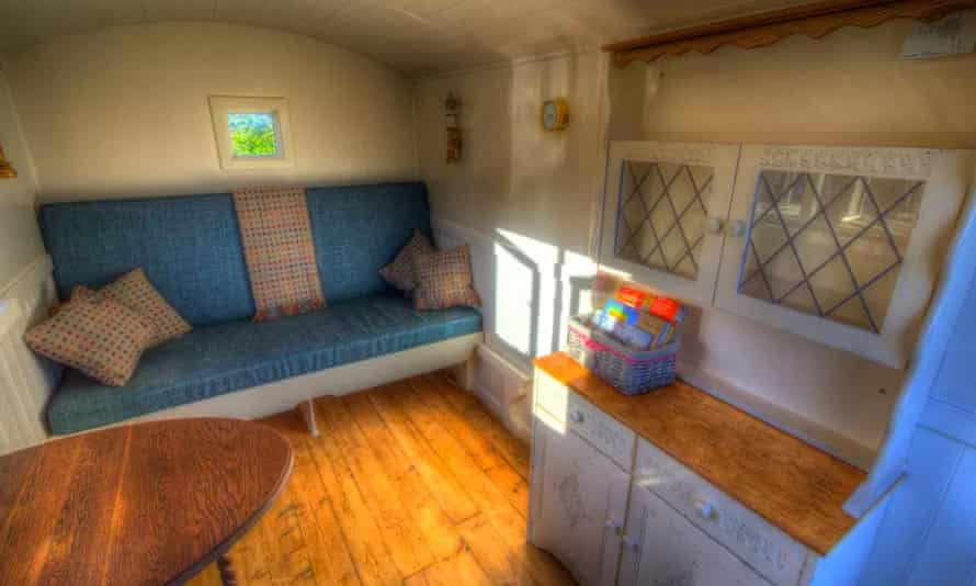 Interior of the Shepehrd's Hut cottage by Glamping Under Stars, Wales