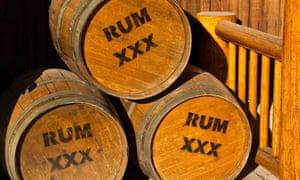 Three wooden casks of rum at dockside