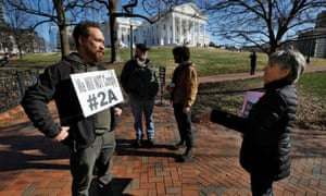 A gun rights activist outside the Virginia state capitol building as the general assembly prepares to convene in Richmond, 8 January 2020.