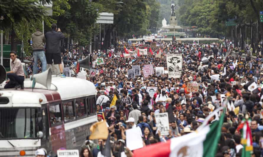 People take part in a protest for the 43 missing students from Ayotzinapa normal school on Saturday in Mexico City.