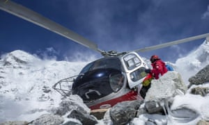 A rescue helicopter is shown at the Mount Everest south base camp in Nepal. Rescue teams, helped by clear weather, used helicopters to airlift scores of people stranded at higher altitudes, two at a time.