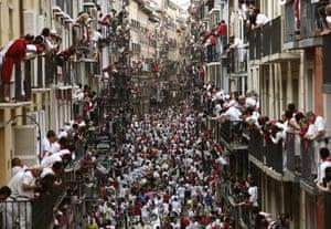 People watch the fourth bull run of the San Fermín festival