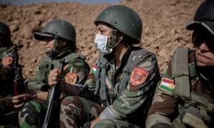 A female Syrian Kurdish Peshmerga unit at a forward fighting position.