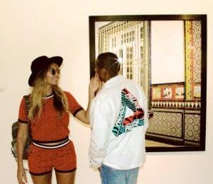Jay Z in Paris with Beyoncé, wearing a Palace shirt