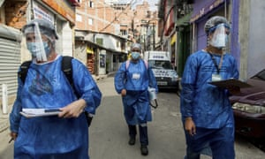 "Members of the ""Bora Testar"" or Let's Test project, walk through the the Paraisopolis neighbourhood of Sao Paulo, Brazil, on 11 September 2020."