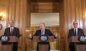 Boris Johnson flanked by Chris Whitty, left, and Patrick Vallance, during a news conference 3 March.