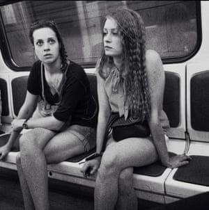 Two girls ride the metro on a hot summer's day