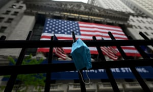 a face mask hangs on railing outside the new york stock exchange