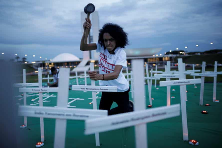 Greenpeace activists set up crosses in Brasília in memory of people killed during conflicts in the Amazon.