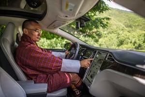 Bhutan's prime minister, Tshering Tobgay, in his electric car