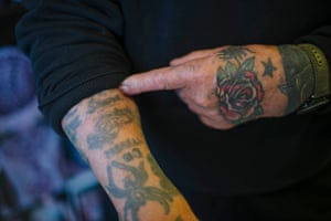 Doc Price shows some of the tattoos on his arms.
