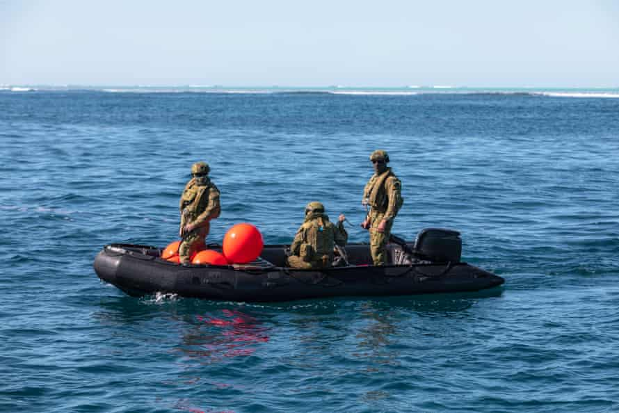 Australian Clearance Diving Team One prepare their diving equipment on a Zodiac inflatable boat near Elizabeth Reef.