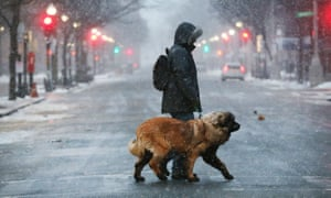 A man walks his dog through the snow in Boston on 4 January.