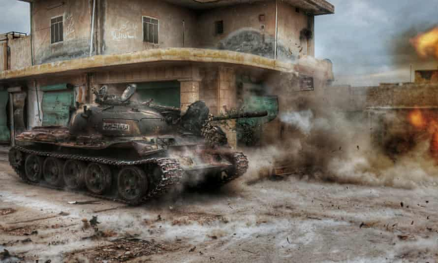 Members of a Syrian opposition group attack the headquarters of Assad regime forces in the villages of Nubul and al-Zahraa in Aleppo, Syria on 12 February 2016.