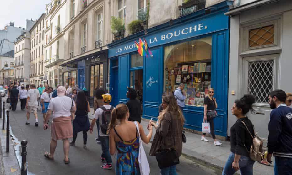 People walk past the Les Mots à La Bouche bookshop