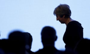 Theresa May leaves the stage after giving a speech at the United Jewish Israel Appeal charity dinner in London